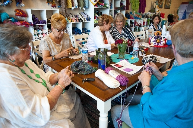 From left, Deanna Werner, Diane Geisler, Marsha Barnett, Debbi McCarty, Catherine Carton and Elaine Sherman work on projects during a class at the Sin City Knit Shop May 18.