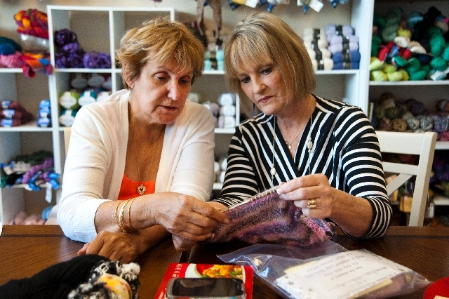 Marsha Barnett, left, and Debbi McCarty talk about the proper ways to knit during a class at the Sin City Knit Shop, 2185 E. Windmill Lane, May 18. The Henderson shop offers classes for beginners  ...