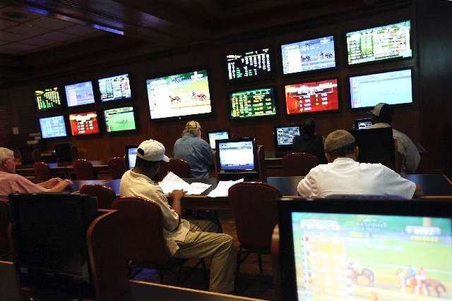 Patrons watch races at the El Cortez sports book in Las Vegas. A measure that would have allowed private equity groups to place large bets at Nevada sports books appears dead this in this Legislature.