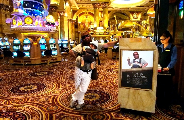 """Brian Petre poses Friday at Caesars Palace near resort employee Roselinda Marasidan's work site. Impersonating the character Alan from """"The Hangover"""" allowed Petre to quit his job as a welder to a ..."""