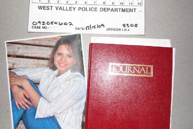 This evidence photo released Monday by the West Valley City Police Department shows a journal collected from Josh and Susan Powell's house. Citing a lack of leads, a police agency said Monday that ...