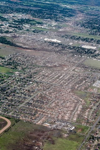 An aerial view of Monday's tornado path in Moore, Okla., is seen Tuesday. At least 24 people, including nine children, were killed in the massive tornado that flattened homes and schools.