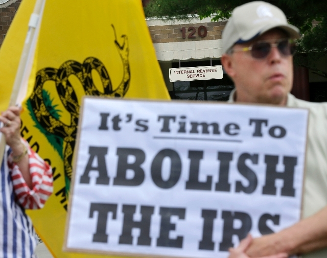 Cliff Toye of Tabernacle, N.J., takes part in a tea party rally Tuesday outside the Internal Revenue Service offices in Cherry Hill, N.J. The rally was to protest extra IRS scrutiny of conservativ ...