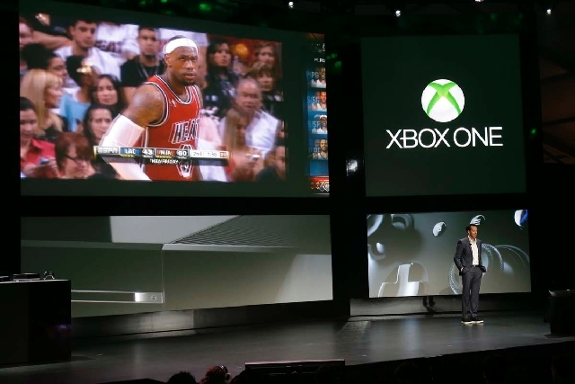 Yusuf Mehdi, senior vice president of Microsoft's interactive entertainment business, talks about the next-generation Xbox One entertainment and gaming console system's capabilities for viewing li ...