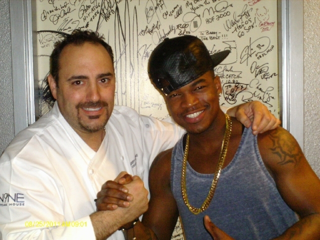 Ne-Yo took friends to N9NE Steakhouse Sunday for lobster bisque and signed the celebrity door of chef Barry Dakake.