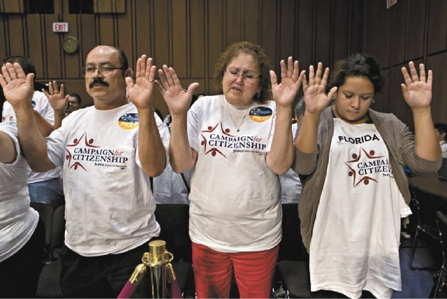 Immigration activists gather to pray on Capitol Hill in Washington, Monday, before the Senate Judiciary Committee began work on a landmark immigration bill to secure the border and offer citizensh ...