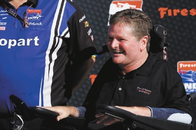 IndyCar team owner Sam Schmidt hangs out in the winner's circle at the Las Vegas Motor Speedway on Oct. 14, 2011. Schmidt has three cars that will run in this Sunday's Indianapolis 500.
