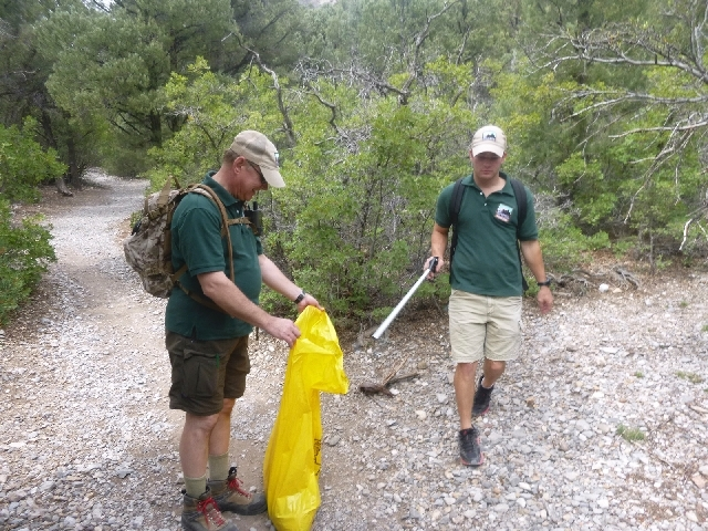 Trail host volunteers Bob Grozenski, left, and Aaron Carson pick up litter last summer on a Mount Charleston trail. Grozenski is one of five returning volunteers scheduled to start a second stint  ...
