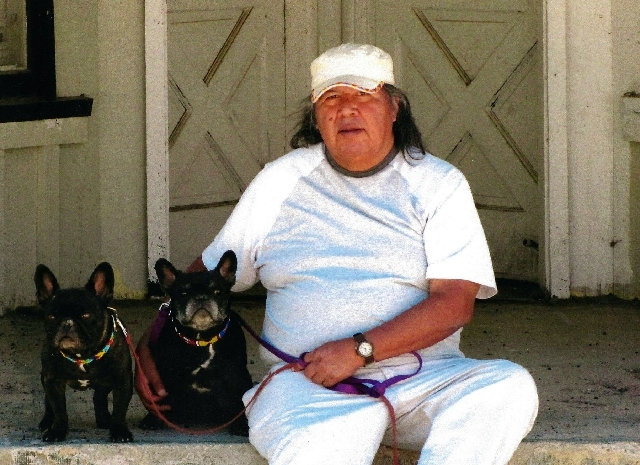 Former Moapa Band of Paiutes Chairman Calvin Meyers poses with his dogs in this undated photo.  He died May 15, 2013 of complications from a stroke. He was 57.