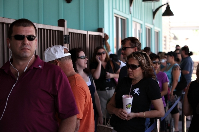 Crowds wait in line to buy and pick up season passes Wednesday at Wet 'n' Wild in Las Vegas. The park will open to the general public on June 3.