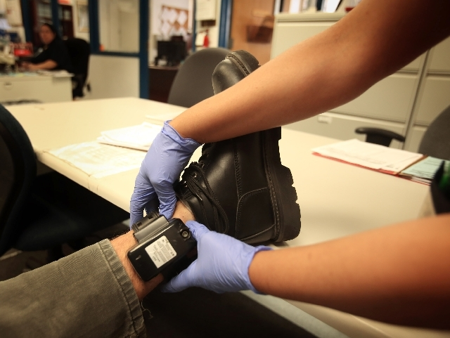 Inmates in the Metropolitan Police Department's house arrest program wear ankle bracelets complete with a box-shaped GPS small enough to cover with jeans.
