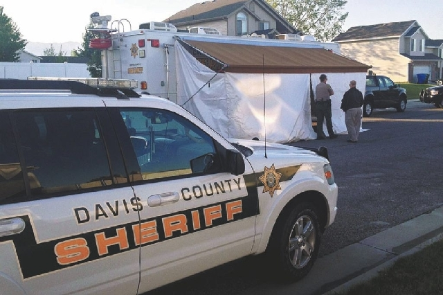 Law enforcement officials from Davis County, Utah, investigate the deaths of two young boys Thursday morning in West Point. An older brother was being questioned in the deaths of the two boys foun ...