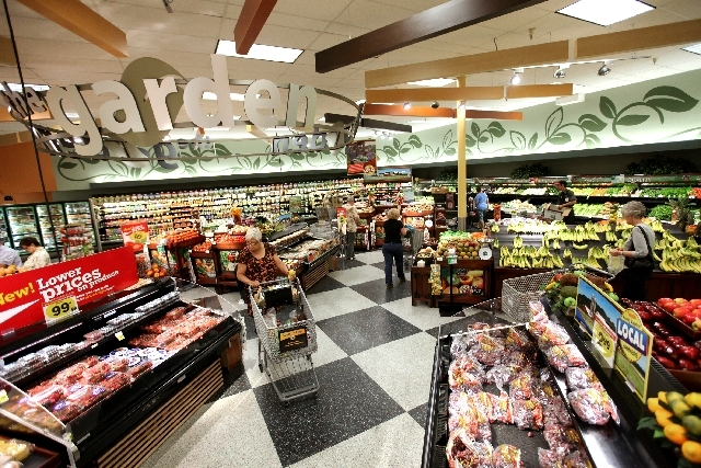 Shoppers look over produce May 23 at the Smith's on South Boulder Highway in Henderson. This location is one that has undergone renovations that include the installation of LED lights and other en ...