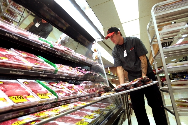 Nate Fulton stocks meat products under LED lights, above left, at the Smith's location on South Boulder Highway in Henderson on Thursday. This location is one that has undergone a renovation that  ...
