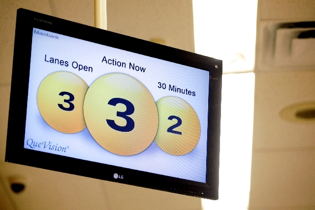 A display that shows information about checkout counters is seen at the Smith's location on South Boulder Highway in Henderson on Thursday. Heat sensors signal how many shoppers are in the store a ...