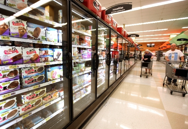 Shoppers browse a frozen food section at the Smith's location on South Boulder Highway in Henderson on Thursday. On this aisle, sensors monitor shoppers and automatically shut off the lights if th ...