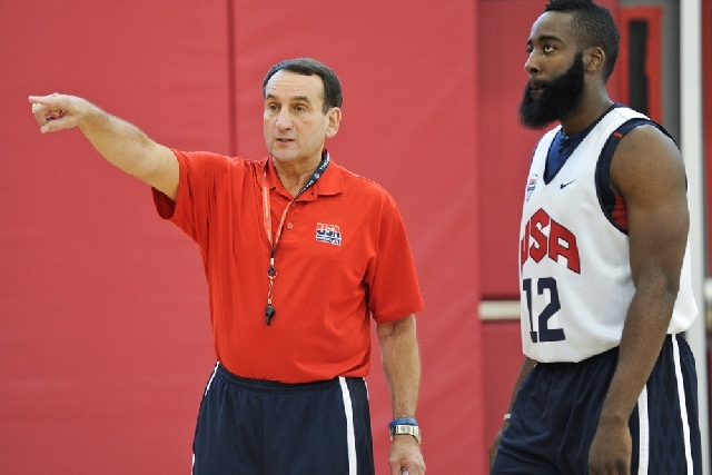 U.S. Olympic Men's Basketball Coach Mike Krzyzewski, left, talks with guard James Harden before practice at the Mendenhall Center at UNLV in this 2012 file photo. Kryzewski will return to coach Te ...