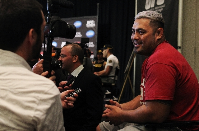 Fighter Mark Hunt answers questions during the UFC 160 media day at the MGM Grand in Las Vegas on Thursday. Hunt goes up against former champion Junior Dos Santos Saturday night, and could be the  ...