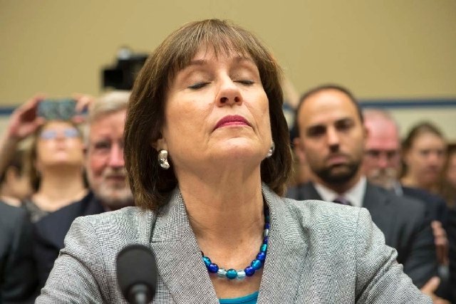 Lois Lerner, head of the IRS unit that decides whether to grant tax-exempt status to groups, was placed on administrative leave Thursday, IRS officials said. Lerner is shown here on Capitol Hill i ...