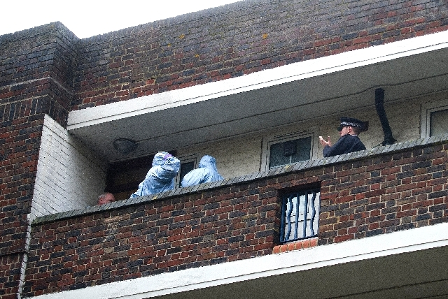 Police officers search an apartment in Greenwich, south London believed to be the residence of the second suspect in the attack on Wednesday, in London on Friday. Police raided houses in connectio ...