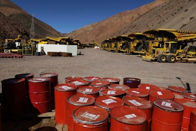 Mining machinery and barrels with chemicals sit on the facilities of Barrick Gold Corp's Pascua-Lama project in northern Chile on Thursday. Chile's environmental regulator has stopped construction ...