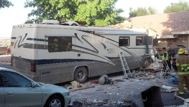This image provided by the Utah Highway Patrol shows a crash site on Friday  in St. George, Utah. Two people died after the RV carrying 10 people went off the highway and crashed through a fence a ...