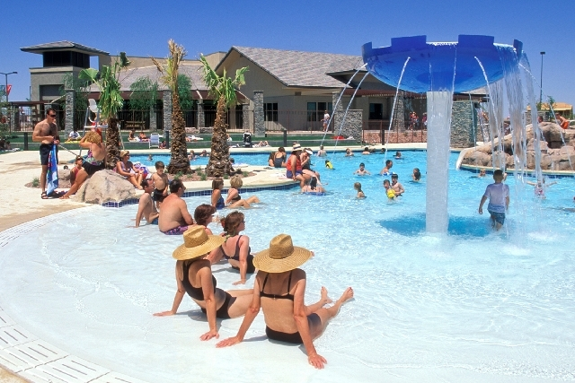 Summerlin residents relax and sun themselves at this beach-style private community pool in The Willows village.