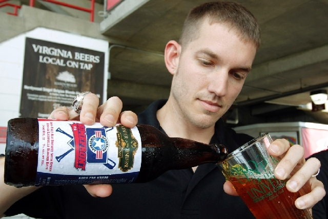 Former major league pitcher Chris Ray pours one of his baseball-themed beers at The Diamond in Richmond, Va.