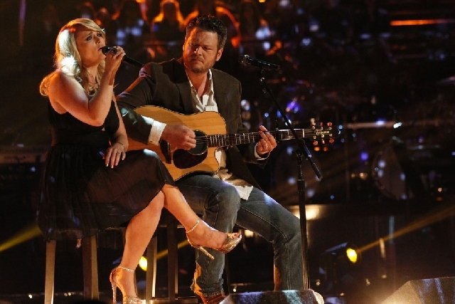 """Married singers Miranda Lambert, left, and  Blake Shelton perform during a telecast of NBC's """"The Voice."""" Shelton and NBC are putting together a benefit for Oklahoma tornado victims. Shelton, an O ..."""