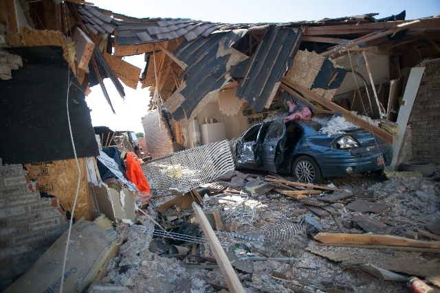Debris from a home that was destroyed when an RV crashed on Friday in St. George, Utah.