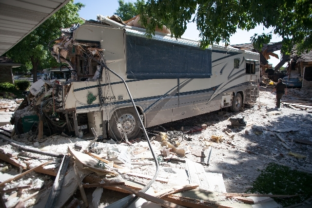 An RV sits after it crashed into several townhomes on Friday in St. George, Utah.