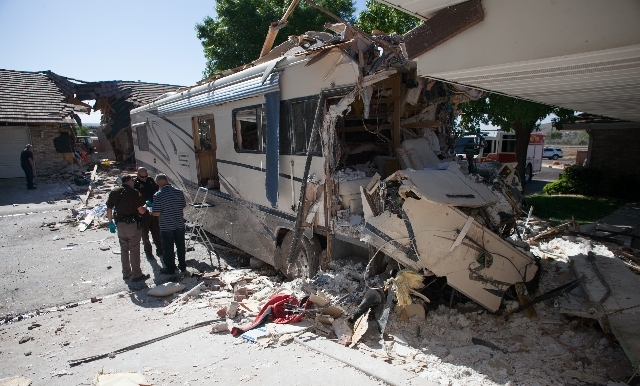 Police investigate after a motorhome crashed into several townhomes on Friday in St. George, Utah.