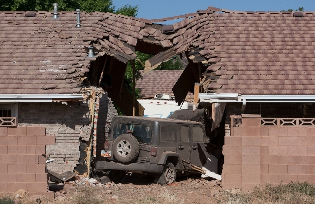 A Jeep that was being towed behind an RV crashed into several townhomes on Friday in St. George, Utah. A Provo couple on a family recreational vehicle trip was killed when their motorhome crashed  ...