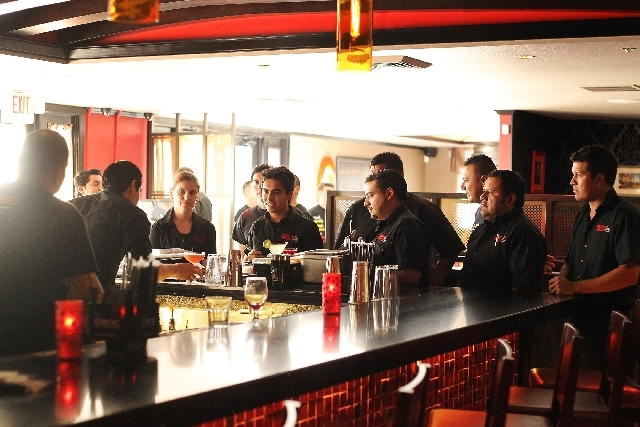 Restaurant staff meet for the pre-dinner menu briefing as Firefly opens their new location at 3824 Paradise Road on Friday