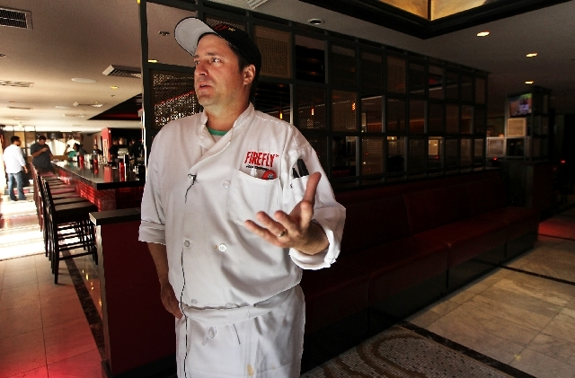 Chef and owner John Simmons speaks to the media as Firefly opens their new location at 3824 Paradise Road in Las Vegas on Friday.