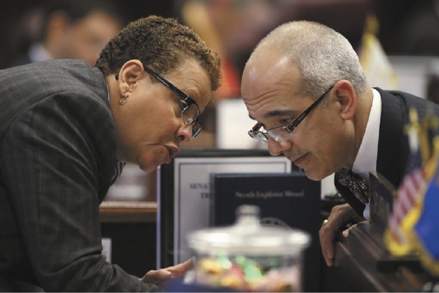 Nevada Senate Democrats Pat Spearman and Mo Denis talk on the Senate floor at the Legislative Building in Carson City on Friday. Spearman's bill to extend voter registration deadlines cleared the  ...