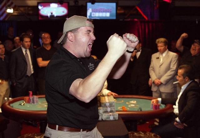 Chris Moneymaker of Spring Hill, Tenn., celebrates his World Series of Poker victory over Sam Farha, seated right, at Binion's Horseshoe on May 24, 2003. Moneymaker, who never had played in a live ...