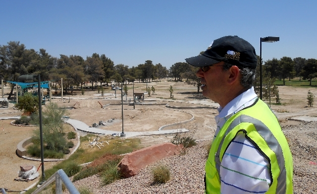 North Las Vegas Parks and Recreation Director Mike Henley looks over unfinished playgrounds May 22 at Craig Ranch Regional Park, 628 W. Craig Road. City officials look to open the park Labor Day w ...