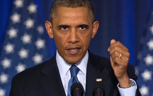 President Barack Obama is seen at the National Defense University at Fort McNair in Washington during a speech in which he sought to refine and recalibrate his counterterrorism strategy, and asser ...