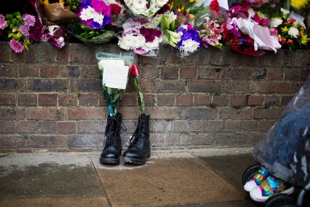 Military boots are laid in tribute outside the Woolwich Barracks, in London, in response to the bloody attack on Wednesday when a British soldier was killed in the nearby street. Counterterrorism  ...