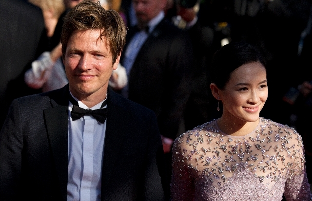 Un Certain Regard jury president and director Thomas Vinterberg, left, and jury member and actress Zhang Ziyi pose for photographers as they arrive for the screening of Venus in Fur at the 66th in ...