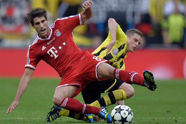 Bayern's Javi Martinez of Spain, vies for the ball with Dortmund's Sven Bender during the Champions League Final soccer match between Borussia Dortmund and Bayern Munich, at Wembley Stadium in Lon ...