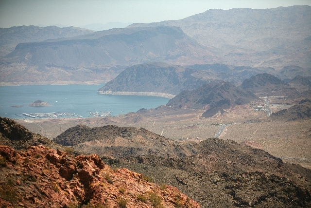 A light haze fills the air in this view of Lake Mead National Recreation Area as seen Saturday from Bootleg Canyon Park in Boulder City. Gusty winds kicked up dust and other pollutants to start th ...