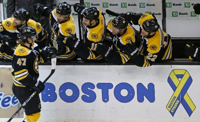 Boston Bruins defenseman Torey Krug (47) is congratulated by teammates after his goal against the New York Rangers during the second period in Game 5 of the Eastern Conference semifinals in Boston ...
