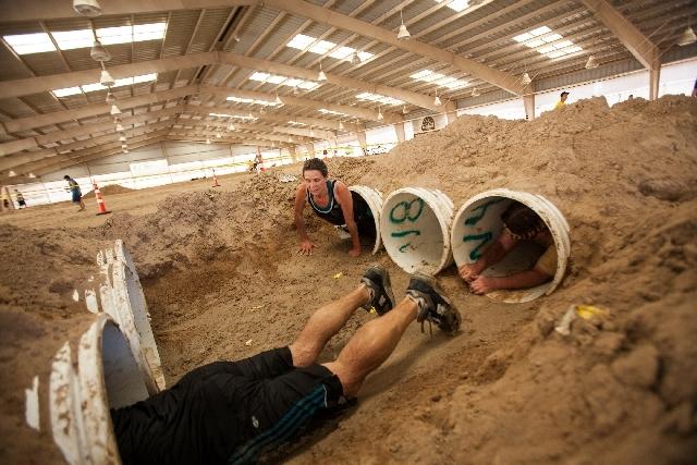 Participants make their way through the Claustrophobic Crawl.