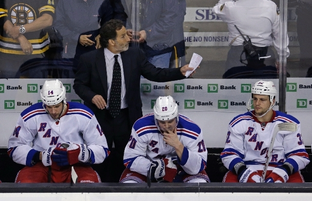 New York Rangers head coach John Tortorella, top, calls to his players late in the third period while facing the Boston Bruins in Game 5 of the Eastern Conference semifinals in the NHL hockey Stan ...