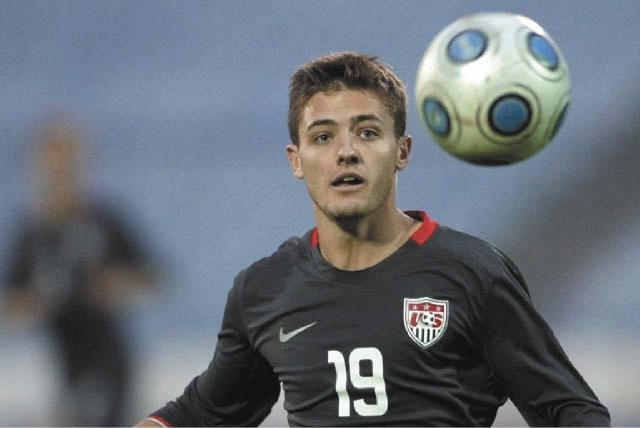 Robbie Rogers, of the United States, eyes the ball during a friendly soccer match against Slovakia in Bratislava, Slovakia on Nov. 14, 2009. Rogers is joining the Los Angeles Galaxy of Major Leagu ...