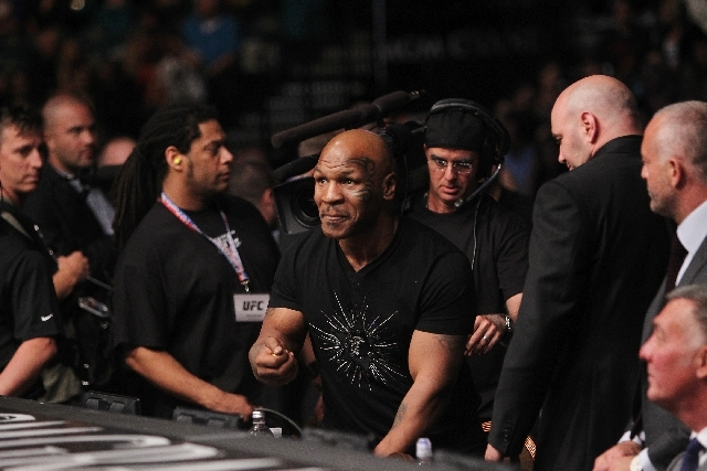 Former heavyweight boxing champion Mike Tyson hangs out with UFC president Dana White, right, on Saturday during UFC 160.