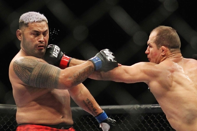 Junior dos Santos, rights, lands a blow against Mark Hunt during UFC 160 at the MGM Grand Garden Arena in Las Vegas on May 25.