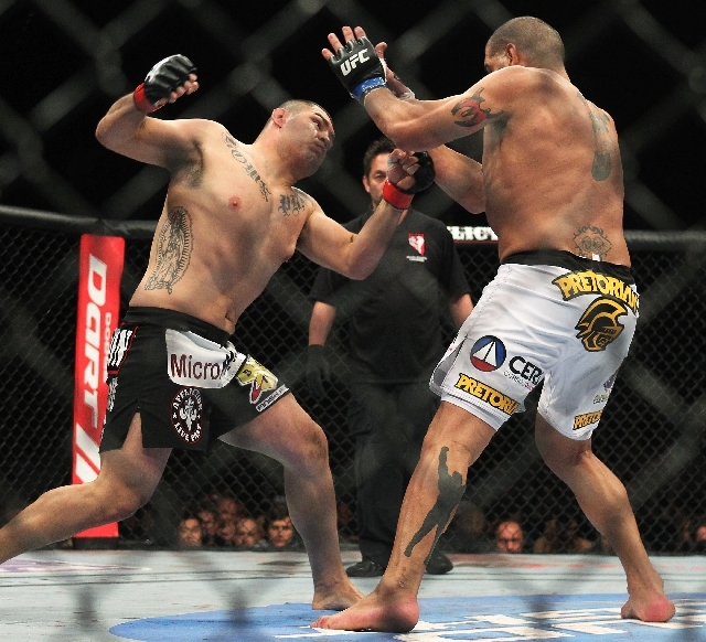 Cain Velasquez goes on the attack against Antonio Silva in their heavyweight title bout in UFC 160 on Saturday at the MGM Grand Garden. Velasquez kept the belt with a knockout 1:21 into the first  ...
